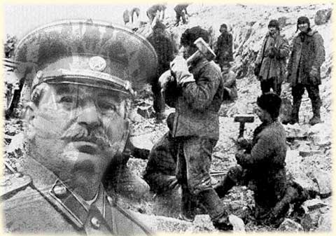 An image of Iósiv Stalin is superimposed on a photograph of a forced labor camp